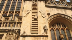 Tilt up shot of Jacob's Ladder sculpture on a church in Bath, England. Stock Footage