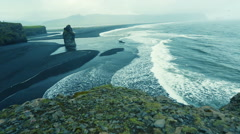 Dyrholaey, a black volcanic sea arch. Stock Footage