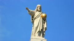 Statue of a man with a golden religious emblem in his hand. Stock Footage