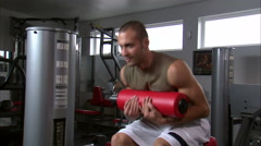 Man doing sitting curls in a gym. Stock Footage