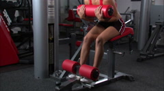 Woman doing curls on an exercise machine. Stock Footage