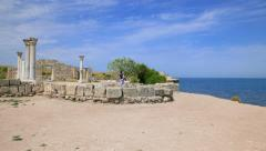 Tourists walk among the ruins of the ancient city of Chersonesos Stock Footage