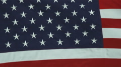 Close up of the blue star field of the American flag rolling in the wind. Stock Footage