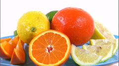 Assortment of citrus fruit rotating on a plate on a white screen. Stock Footage