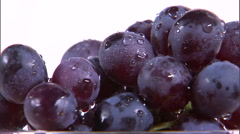 Close shot of grapes rotating on a white screen. Stock Footage