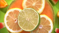 Close shot of an assortment of fruit on a white screen. Stock Footage