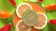 Stock Video Footage of Zoom out shot of an assortment of fruit on a white screen.