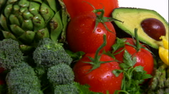 Close shot of an assortment of vegetables rotating on a white screen. - stock footage