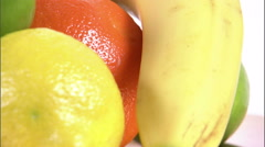 Close shot of assorted fruit on a white screen. Stock Footage