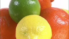 Close shot of citrus fruits rotating on a white screen. Stock Footage