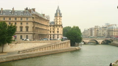 Parisian building seen across the Seine River in France. Stock Footage