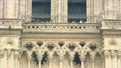 People on the balcony of the Notre Dame Cathedral towers in Paris. Stock Footage