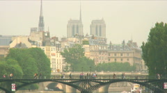 Royalty Free Stock Footage of Pedestrian bridge over the Seine with Paris Stock Footage