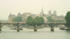 Royalty Free Stock Footage of Ferries going under bridges on the Seine in Paris, Stock Footage