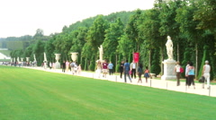 Royalty Free Stock Footage of Statues and a walkway surrounding a long lawn in Stock Footage