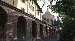 Architecturial building with arches along one side in Italy. Stock Footage