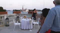 People having dinner on a hotel rooftop balcony overlooking Saint Mark's Canal. Stock Footage