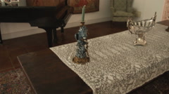 Tilting up shot in a Italian room with a dining table and a baby grand piano. Stock Footage