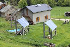 Mountain chalet with solar panels Stock Photos