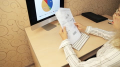 Business Girl analyzing investment charts - stock footage