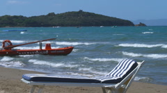 Woman sunbathing on a beach in Italy. Stock Footage