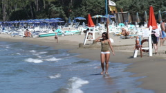 Woman walking along the beach in Italy. Stock Footage