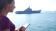 Woman with Tablet Computer Travelling by the Sea Stock Footage