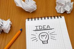 Idea and light bulb - stock photo