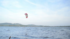 Kite-surfing on the lake on a clear, windy day - stock footage