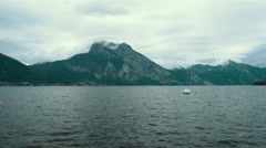 Beautiful lake in the Alps on the gloomy weather. Stock Footage