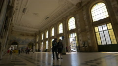 Walking inside the Sao Bento Train Station in Porto Stock Footage