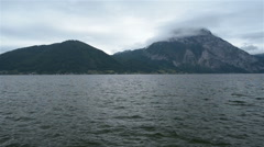 Beautiful lake in the Alps on the gloomy weather Stock Footage