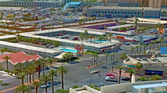 Panning time-lapse shot of an intersection near hotels in Las Vegas Stock Footage