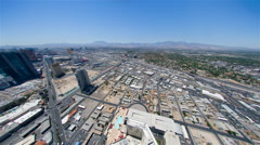 Static view from the Las Vegas Stratosphere Hotel to traffic and mountains in Stock Footage