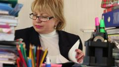 Senior woman bookkeeper in glasses and with commercial papers - stock footage
