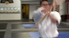 Close up of a martial artist using a bo staff and bowing. Stock Footage