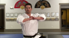 Close up of a martial arts instructor performing Tae Kwon Do. Stock Footage