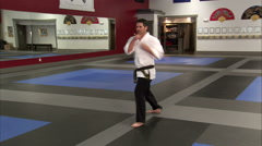Man showing punches and kicks at a karate studio. Stock Footage