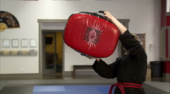 Close up of a bag being kicked at a karate studio. Stock Footage