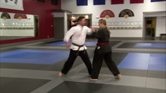 Martial arts instructor getting flipped over by his student. Stock Footage
