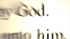 A bible opened to highlighted words in John 20:29, lingers and pulls back as the Stock Footage