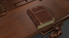 A bible on a desk opens, the pages turn to Noah, and zooms past the words into Stock Footage