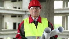 Master builder at construction site Stock Footage