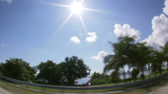Stock Video Footage of Wide angle lens driving down oceanside freeway in Miami.