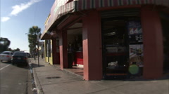 Driving by shops in Miami with a wide angle lens. Stock Footage