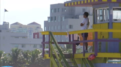 Lifeguard standing watch from a tower in Miami. Stock Footage