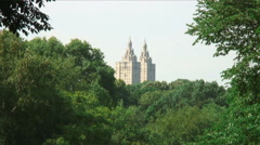 Tower buildings seen in the distance above trees in New York City. Stock Footage