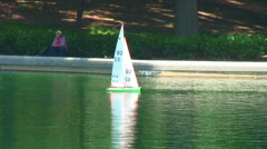 Toy sailboat on a pond. Stock Footage