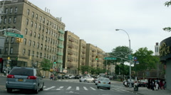 Driving past Bronx buildings from driver's POV in 4K, NYC Stock Footage