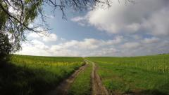 Rural gravel road in spring and sky clouds, timelapse 4K Stock Footage